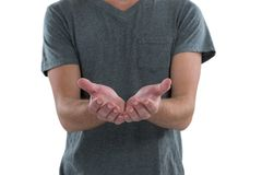Man with cupped hands against white background Stock Photos