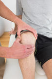 Mid section of a man getting his knee examined Royalty Free Stock Photo