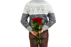 Mid section of man hiding red roses Stock Photo