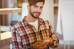 Mid section of man holding cup of coffee. In office cafeteria Royalty Free Stock Photos