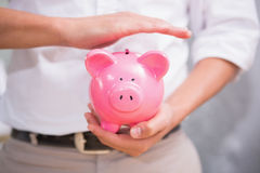 Mid section of man holding piggy bank Stock Photography