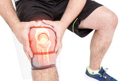 Mid section of man holding sore knee. Against white background Stock Image