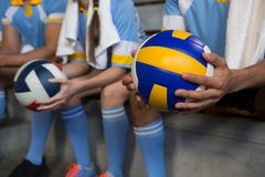 Mid section of man holding volleyball Stock Photos