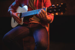 Mid-section of man playing guitar Stock Photos