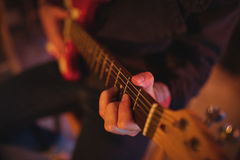 Mid-section of man playing guitar Stock Photography