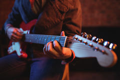 Mid-section of man playing guitar Royalty Free Stock Image
