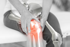 Mid section of man suffering with knee inflamation Stock Photo