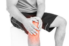 Mid section of man suffering with knee pain Stock Photo