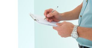 Mid section of man writing on a clipboard Royalty Free Stock Photo