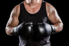 Mid section of muscular boxer. On black background Stock Photo