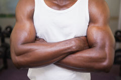 Mid section of a muscular man with arms crossed Stock Photo
