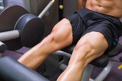 Mid section of muscular man doing a leg workout Stock Image
