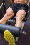 Mid section of muscular man doing a leg workout Royalty Free Stock Photos