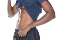 Mid section of a muscular man showing his abs Stock Photography
