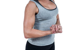 MId section of muscular woman flexing muscle Stock Photo