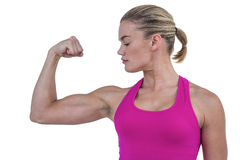 MId section of muscular woman flexing muscle Royalty Free Stock Images