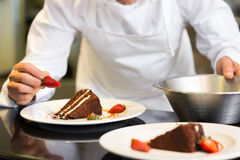 Mid section of pastry chef decorating dessert Royalty Free Stock Photography
