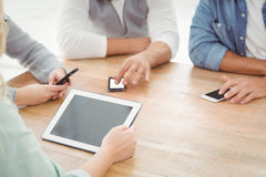 Mid section of people using smartphones and digital tablet Royalty Free Stock Photography