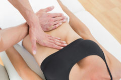 Mid section of a physiotherapist massaging womans body Royalty Free Stock Images