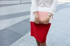 Unrecognizable Businesswoman Holding Folder royalty free stock photography