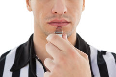 Mid section of referee blowing whistle Stock Images