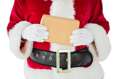 Mid section of santa claus holding box Royalty Free Stock Photo