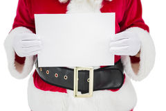 Mid section of santa claus holding page Stock Image