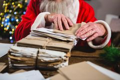 Santa Claus removing a letter. Mid-section of Santa Claus removing a letter Stock Photo