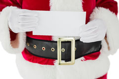 Mid section of santa claus showing card Royalty Free Stock Image