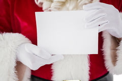 Mid section of santa holding card Royalty Free Stock Photo