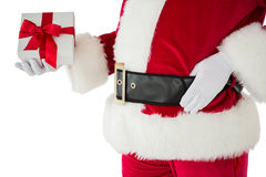 Mid section of santa holding gift Royalty Free Stock Image