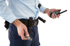 Mid section of security officer holding a walkie-talkie Stock Photos