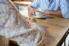 Mid section of senior couple having coffee Royalty Free Stock Photos