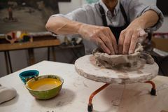 Mid-section of senior man molding clay Royalty Free Stock Images