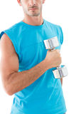 Mid section of a serious man exercising with dumbbell Stock Photography