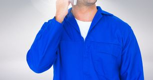 Mid section of serviceman talking on mobile phone Royalty Free Stock Image