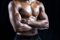 Mid section of shirtless athlete standing with arms crossed Royalty Free Stock Photos