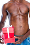 Mid section of shirtless macho man holding gifts Stock Image