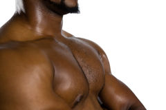 Mid section of shirtless male rugby player with arms crossed Royalty Free Stock Image