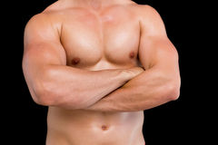 Mid section of shirtless muscular man with arms crossed Stock Photography