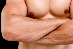 Mid section of a shirtless muscular man with arms crossed Stock Photo