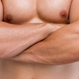 Mid section of shirtless muscular man with arms crossed Royalty Free Stock Photos