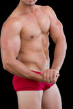 Mid section of a shirtless muscular man Stock Image