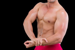 Mid section of a shirtless muscular man Royalty Free Stock Photos