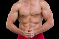 Mid section of a shirtless muscular man Stock Photography