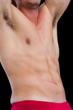 Mid section of a shirtless muscular man Royalty Free Stock Image