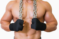 Mid section of a shirtless muscular man holding chain Stock Photography