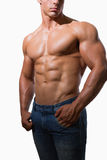 Mid section of a shirtless muscular man Royalty Free Stock Images