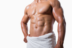 Mid section of a shirtless muscular man in white towel Stock Photography
