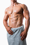 Mid section of a shirtless muscular man in white towel Stock Images